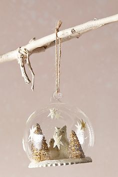 Arctic owls snow globe ornaments http://www.anthropologie.com/anthro/product/home-holiday-trim/33239658.jsp#/