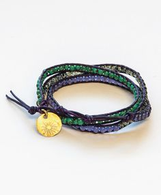This must-have wrap bracelet features glass beads in rich gemstone shades and is finished with a classic Noonday Collection charm.  #handmade #kenya #wrap #bracelet