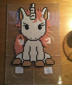 Unicorn perler beads by m.barkani - Pattern: https://de.pinterest.com/pin/374291419013031059/