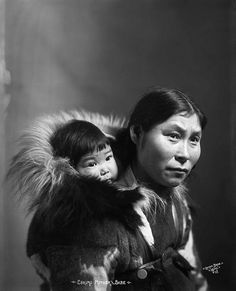 Inuit mother and baby in fur parka c.1903-1915 canada