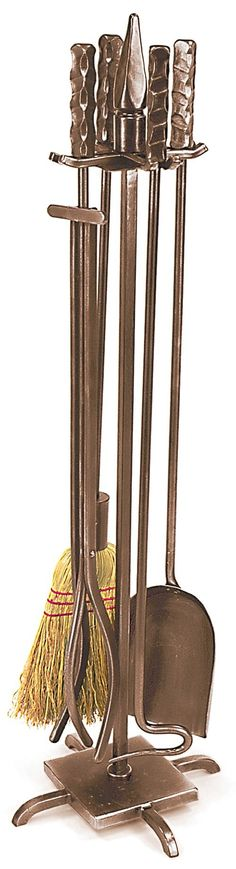 Features:  -Material: Wrought iron.  -Wright design.  -Set includes stand, poker, brush, shovel and tongs.  Product Type: -Fireplace tool.  Material: -Iron. Dimensions:  Overall Height - Top to Bottom