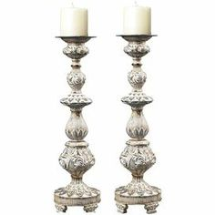 """Bring an eye-catching pop of style to your home with this weathered candleholder, featuring a turned silhouette and textural detailing.   Product: Set of 2 candleholdersConstruction Material: CompositeColor: Pilmico Features: Gold highlightsAccommodates: (1) Candle - not includedDimensions: 19"""" H x 5.25"""" Diameter"""