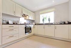 Cream units oak worktops kitchens pinterest oak for Cream kitchen carcasses