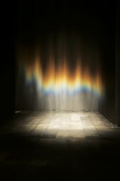 Olafur Eliasson - Beauty, 1993, fresnel lamp, water, nozzles, hose, wood, and pump, dimensions variable