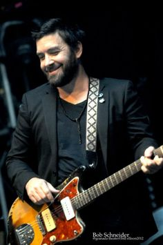 Bob Schneider | 12/29/12. He looks a bit like George Clooney, but more rugged!