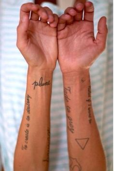 A bunch of small tattoos
