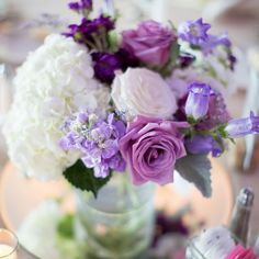Tables were decorated with shabby chic purple centerpieces in mason jar vases.