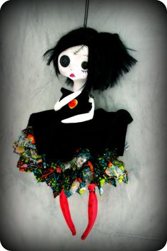 Made of air dry clay, Rita is jointed at the hips and shoulders. There is a thread attached to the head to hang the doll on a wall. She is a delicate fairy around 25 cm * 9.8 inches. Her dress is mainly handstitched. Viscose hair.