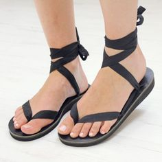 Sseko Sandals.  You can use a variety of ribbons as laces and can tie them tons of different ways.  Very versatile!