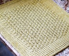 Pretty up your dish drying routine with this lovely Tunisian crochet drying mat!