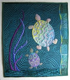 Faberge Turtles   The Secret Life of Mrs. Meatloaf  Applique fabric and quilting thread make these turtles 'Faberge'.  I made the turtles like the ones in my quilt It's Turtles All the Way Down, using silk and velvet and metallic thread to make them gleam like little jewels.