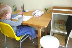 A beautiful example of a child sized writing area, with other Montessori Language Arts activities and work for the child to choose!