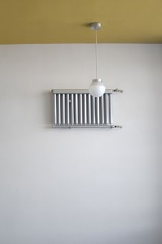 An elevated radiator vent -- in the place of a mural or painting -- on the staircase of Gropius' Bauhaus building