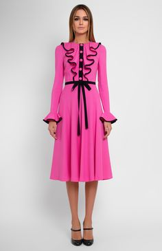 Slim-fit pink dress with flounce long sleeves decorated with black genuine silk. Round neck. Placket with silk buttons and jabot. Cotton ribbon belt. Hidden back zip closure. Without pockets. On the photo: model is wearing a size S and is 180 cm.