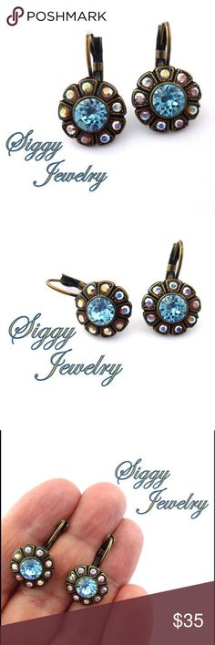 Swarovski Crystal Aqua and Topaz Flower Earrings Victorian Style drop earrings made with genuine Swarovski crystals. The centers are 6mm aquamarine and the petals are shimmering AB.  The nickel free antique brass finish gives them a romantic vintage look. Gift packaging is included. Google Siggy Jewelry to view the rest of the collection and read the glowing five star reviews submitted by happy customers world wide. I've been designing jewelry in my private studio for the past five years and…