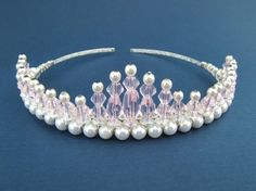 created using soft pink crystal beads,4mm white glass pearls and measures 1.5 inches at its highest peak.