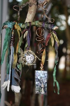 ::Talisman:: The pendant is a picture I took of a centuries old Florida oak tree, Fairchild Oak.  Blue jay feathers represent joy, inquisitiveness and self-confidence. Silk-dyed ribbon adorn a small oak branch from which all these totems hang.