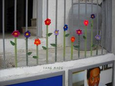 Yarn bombing: flowers on a railing