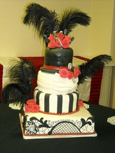 wedding cakes with top hat | White with touches of red. Top hat (cake too) at the top of the cake ...
