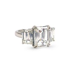 Featuring three emerald cut diamonds, the Luxe Emerald Cut Engagement Ring by Scout Mandolin is timeless and airy in white gold. Known for her expert craftsmanship, Mandolin imbues each ring with unparalleled structural and architectural integrity. #engagementring