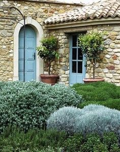 Love the stone, door & window color & the landscaping.