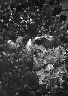 Santa Claus and his assistant distributing free toys to local children at the Hoxton Market Mission in 1936 (Photo by William Vanderson/Fox Photos/Getty Images)