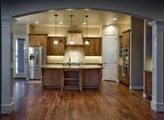 Pepperdign Homes is Utah's Premier home builder. We specialize in affordable spec homes for the modern family. New development and lots are available in Saratoga springs, Utah. House Design, Utah Home Builders, Home, Custom Home Plans, Custom Homes, Modern, Kitchen, Wood Cabinets, Home Kitchens