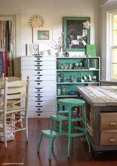 Vintage Craft room with rustic table, green accents in the office and really…