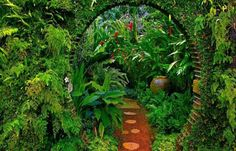 garden design with path and arched entrance