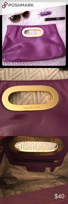MICHAEL Kors purple patent leather clutch Add a pop of color to your outfit with this fun purple patent leather clutch! Gold hardware. Like new! MICHAEL Michael Kors Bags Clutches & Wristlets