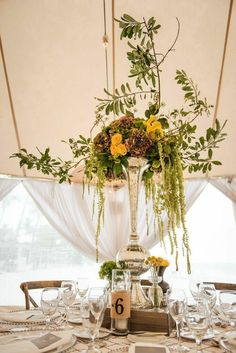 This brilliant Florida wedding shines bright with the most energizing canary and pewter decor. Under an airy tent with strung lights and grand centerpieces, Lizzy and Dave tied the knot with an utterly intimate outdoor affair. The adorable couple entrusted Anna Lucia Events with planning a spectacular event, and that's just with they received. Thanks to photographer Ryan Joseph, we're sharing the inspiring photos below from one stylish beach wedding full of romance.