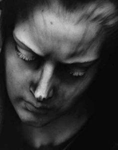 One very special sculpture...Eye lashes in stone, Genova, Staglieno.