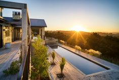 The Lodge — Te Arai Lodge Open Fireplace, Fireplace Surrounds, Home Design, North Island New Zealand, Outdoor Baths, Timber Beams, Double Entry Doors, Luxury Accommodation, Renting A House
