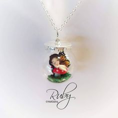 Polymer clay miniature butterfly fairy in a glass orb bottle, by Ruby creations…