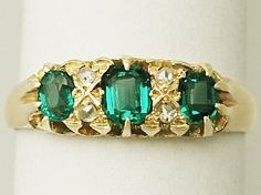 What a gorgeous antique 0.90 carat natural emerald and 0.16 carat diamond, 18…