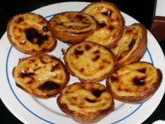 Pasteis De Nata (custard tarts) Best found in a Portuguese bakery. The darker the better! Google Image Result for http://2.bp.blogspot.com/_ZeEnGqZDJ0M/S_ALeGCfJKI/AAAAAAAAB3A/gg4s3L4tSuA/s1600/pasteis2.jpg