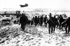 Earlier in 1939, Imperial Japanese army and naval units continued to attack and push forward into China and Mongolia. Here Japanese soldiers advance inland over the beach after landing at Swatow (Shantou), one of the remaining South China coast ports still under Chinese control at that time, on July 10, 1939. After a short engagement with the Chinese defenders the Japanese entered the city without encountering much further opposition.