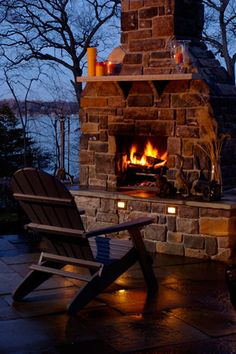 Outdoor living area. The link is different from the pic, but we're loving the idea of this cozy fireplace with all the cold weather.