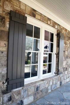 shutters on stone. OMG so beautiful!  A thought to add character to a bland house face.