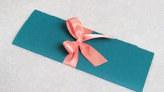 Blue paper wrap with pink ribbon