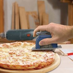 This circular-saw pizza cutter will handle the heaviest cheese jobs.