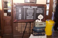 "Our wedding ""itinerary"" board inside Boise Train Depot"