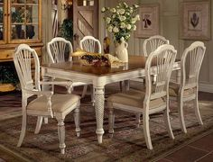 Wilshire Rectangle Table in Antique White features the perfect blend of cottage styling and country details.