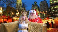 Santa and Christkind visit Christmas Village in LOVE Park, Philadelphia.