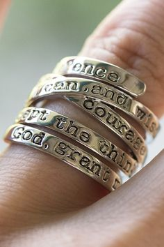 """""""God grant me the serenity to accept the things I cannot change, courage to change the things I can, and the wisdom to know the difference.""""  The powerful prayer of quiet strength coils around your finger on our silvery ring, keeping inspiration on hand during troubled times."""