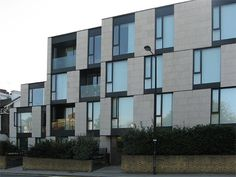 Latitude House uses the shifting alignment of the glazing panels and stone cladding panels to break up the elevation, and indicate the scale of each storey vertically, and the size of each room horizontally.    Ground floor units are afforded considerable privacy through the planting of the front boundary.