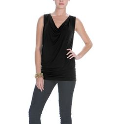 This lightweight jersey and silk charmeuse tunic offers a mixed silhouette