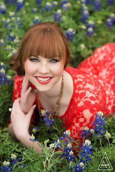 #Senior in a red #dress lying in purple #flowers.