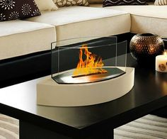 Ethanol Tabletop Fireplace / No more chimneys, pokers, grime or smoke to make things messy when all you need is the warmth and flickering light of your own fireplace. http://thegadgetflow.com/portfolio/ethanol-tabletop-fireplace/