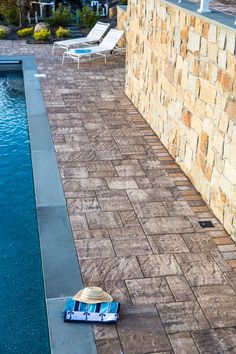 Cappiello Landscape updated this outdoor living space with Cambridge Pavingstones with ArmorTec. Contrast your landscaping with beautiful hardscaping.